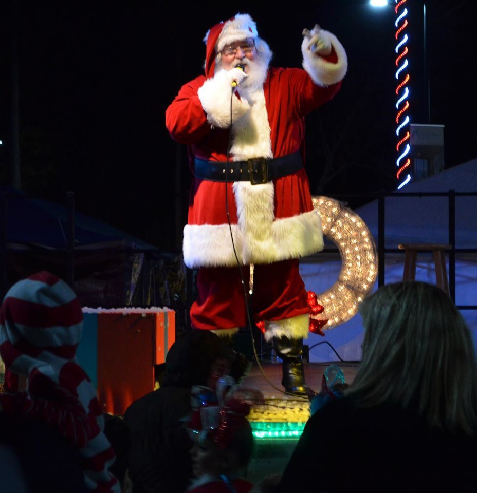 Santa Claus Talking into a Microphone to an Audience